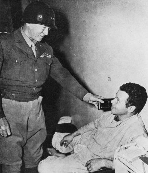 LTG George S. Patton visiting wounded soldier in hospital. Credit: General George S. Patton Jr. Collection
