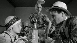 "Tatum O'Neal and Ryan O'Neal in PAPER MOON. ""Just because a man meets a woman in a bar room don't make him your pa!"""