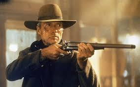 "Clint Eastwood in ""Unforgiven."" Will he remain true to his beloved wife's wish that he become a good man?"