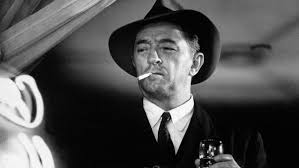 "Robert Mitchum as Philip Marlowe in ""Farewell, My Lovely."""